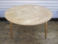 Arts and Crafts light oak circular dining tableon three tapering supports, 120cm diameter approx