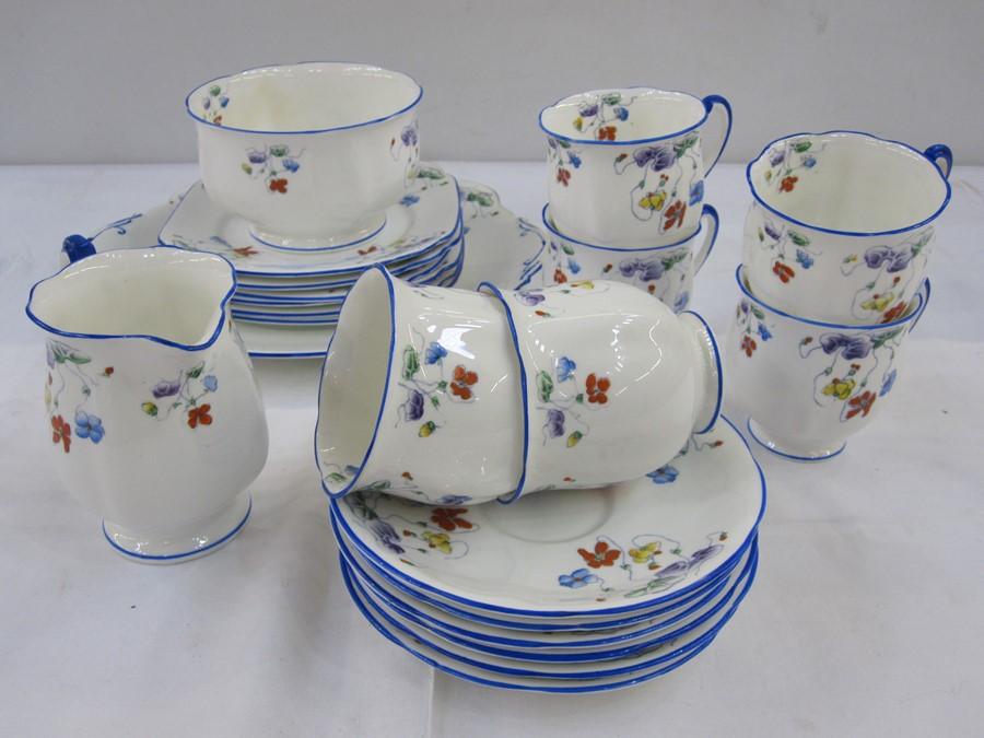 Standard china part tea servicecomprising of six cups, saucers, plates, slop bowl and milk jug,