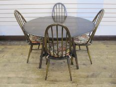 Set of four dark Ercol dining chairsand matching drop-leaf table (5)