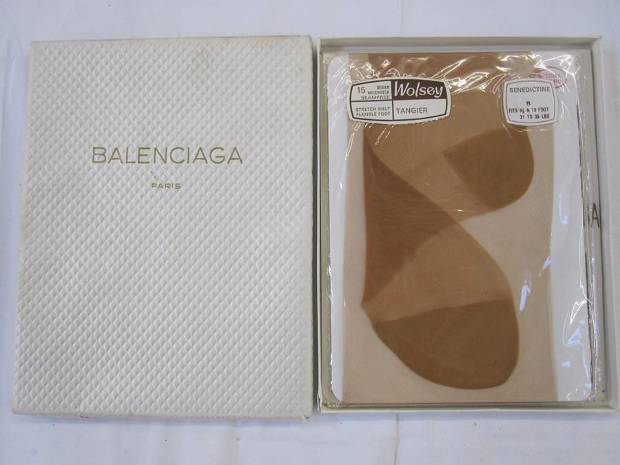 Balenciaga boxcontaining a pair of Wolsey stockings