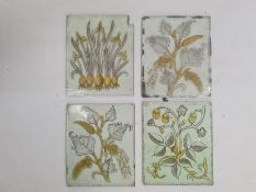 Four hand painted Aesthetic-movement glass panes or quarries, florally decorated, circa 1870,