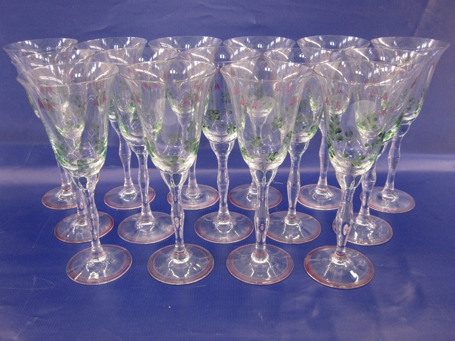 Suite of Orrefors Sweden hand-painted glasses, decorated with purple flowers and green stems, to