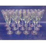 Suite of Orrefors Sweden hand-painted glasses, decorated with purple flowers and green stems,to