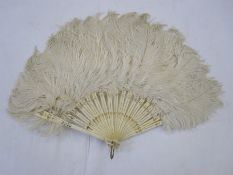Small ostrich feather fanwith bone sticks and guards, with gilt decorations
