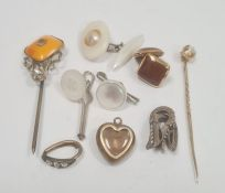 Miniature gilt-coloured and enamel heart-shaped memorial pendantenclosing hair with single white