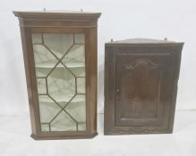 Mahogany wall-hanging corner display cabinet with astragal-glazed door enclosing three shelves and