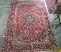 Village red ground Persian Kashan, traditional medallion design rug, 285 x 195cm