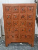 Chinese painted wooden cabinetfitted with sixteen small square drawers and two rectangular