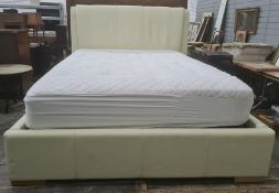 "Double bed with cream upholstered headboard, lift-up base, with mattress, 52"" wide approx and a baby"