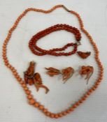 A coral graduated beaded necklace with 9ct gold clasp, coral pendants, earrings and a beaded
