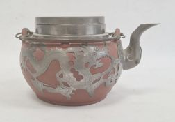 Redware and white metal clad teapot with twin metal loop handle, dragon decorated