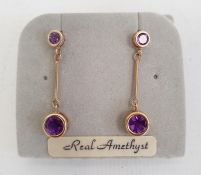 Pair 9ct gold and amethyst drop earrings, each set pair graduated stones Condition