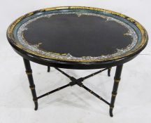 Oval centre tablewith papier mache and mother-of-pearl inlaid tray top, on ebonised bamboo-effect