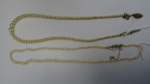 Graduated cultured pearl necklacewith gilt-coloured clasp marked 'Made in France' and another