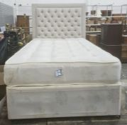 Modern single bed with button upholstered headboard and divan base