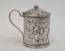 Chinese Wang Hing embossed silver mustard pot, cylindrical and lidded, decorated autour with figures