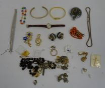 Quantity of costume jewelleryto include clip-on earrings, gold-coloured bangles, rosary beads,