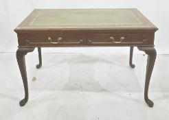 Edwardian library/writing table stamped 'Gillow', with green leather inset top and mahogany frame,