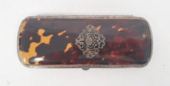 A late 19th century French tortoiseshell and silver pique lorgnette case, silver inlay to lid, red