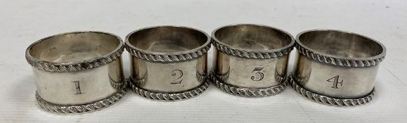 A set of four late 19th century silver napkin rings, numbered 1-4, maker Atkin Brothers, Sheffield
