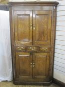 18th century oak floor standing corner cupboard with cavetto cornice, upper section enclosed by pair