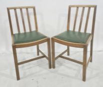 Pair of oak dining chairs with railbacks and curved cresting rail (2)