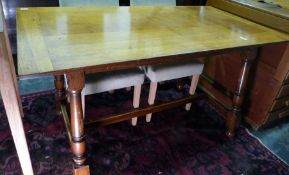 20th century oak rectangular dining tablewith cleated end supports, turned block legs to