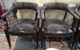 Set of four, possibly Victorian, armchairscovered in green leather, mahogany frames, to brown china