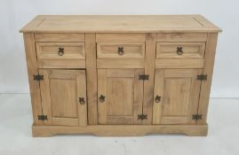20th century pine sideboard, the rectangular top above three drawers, three cupboard doors, plinth
