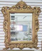 Rectangular bevel edge mirror in gilt-coloured moulded frame, of foliate design, 83cm x 65cm overall
