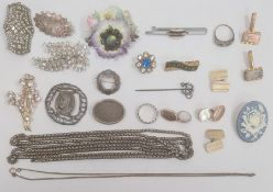 Quantity of silver brooches, a silver-coloured metal chain, a stickpin and two silver-coloured metal