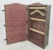 Vintage travelling trunkopening to reveal hanging space and drawers