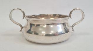 An Edwardian silver two-handled porringer, London 1908, maker Holland, Aldwinckle & Slater, 4.