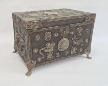 Eastern wooden casketof rectangular form, the body and hinged cover decorated with applied metal