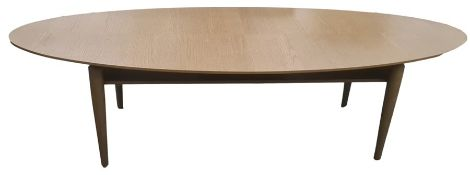 Two modern IKEA Stockholm oval coffee tables in oak finish, on four turned supports and light oak