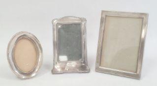 An early 20th century silver mounted photograph frame, Birmingham 1913, a 1930s circular silver