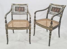 Set of six Regency-style ebonised dining open arm chairs, each with a panel decorated with classical