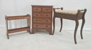 Small chest of two short and three long drawers, on bracket feet, magazine rack and piano stool (3)