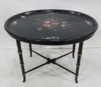 Papier mache tray-topped tablewith floral design, on bamboo-style ebonised base