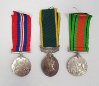 1939-45 Defence medal, 1939-45 War medal and George VI Territorial Efficient Service medal awarded