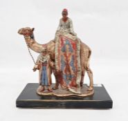 Franz Bergman style coal painted spelter table lighter in the form of Arab carpet seller on camel,