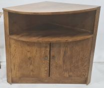 20th century oak corner cupboard, the bow front with under shelf, above two cupboard doors, plinth