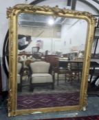 Late 19th century large gilt overmantel wall mirror of rectangular form with beaded border and
