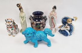Chinese turquoise glazed model Buddhist lion,18cm high, two various bisque and partly glazed figures