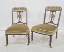 Pair of 19th century low chairs with mahogany inlaid frames, turned front legs to brown china