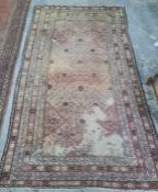 Eastern rug with diamond pattern to the central field, stepped border, 310 x 191cm