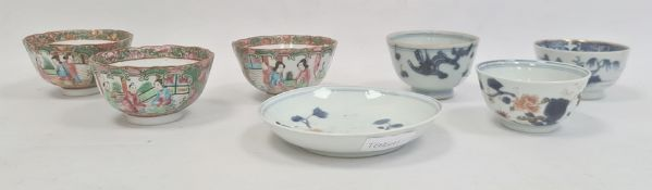 Three Chinese porcelain tea bowls with blue landscape and plant decoration, similar saucerand aset