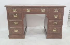 Edwardian walnut pedestal desk, the figured top with moulded edge, the central drawer flanked by