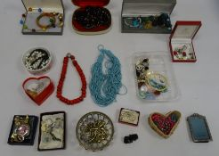 Wooden suitcase and contents of costume jewellery including a glass bead necklace, crystal pendants,