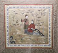 Chinese embroidered silk panelof square form depicting two ladies in a garden, within a border of